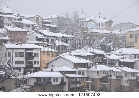 VELIKO TARNOVO BULGARIA - JANUARY 19 2017: Residential area and churches on the hill in the winter