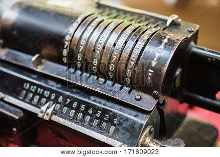 Calculating machine. Old metal computing equipment. Antiques