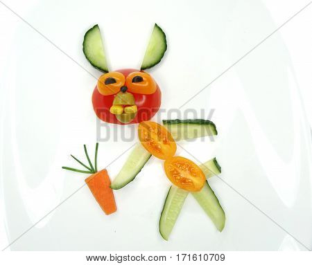 creative funny vegetable food snack with tomato hare form