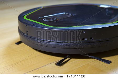 the robot the vacuum cleaner cleans a floor a fragment with brushes