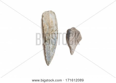 Stone blade - dagger and flint tip isolated on white background. Archaeological findings. Life of ancient man