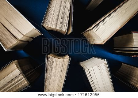top view of old books on a blue table