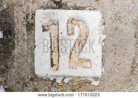 The Digits With Concrete On The Sidewalk 12