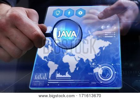 Business, Technology, Internet And Network Concept. Young Businessman Showing A Word In A Virtual Ta