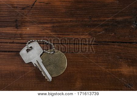 Metal key chain  on vintage wooden background