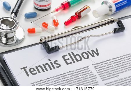 The Diagnosis Tennis Elbow Written On A Clipboard