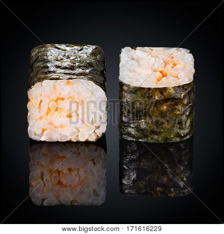 Roll Ebi Spicy Maki, spicy sauce on a black background