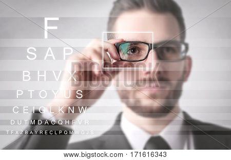 Businessman having an eyetest