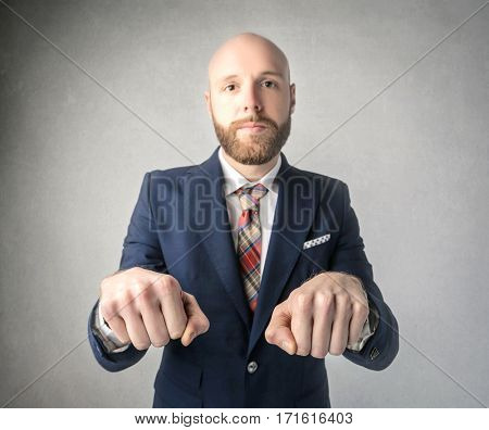 Businessman in blue suit wants to play