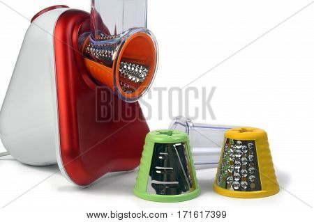 Small electric household appliances for raping and cutting vegetables photographed on white background