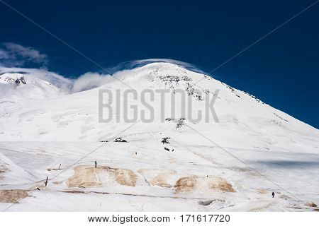 Beautiful view of Elbrus' summit. Group of climbers make the ascent to the summit of Mount Elbrus