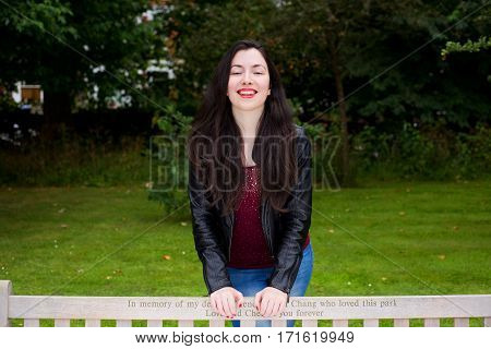 a beautiful happy girl in the park