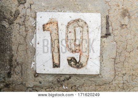 The Digits With Concrete On The Sidewalk 19