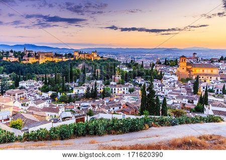 Alhambra of Granada Spain. Alhambra fortress and Albaicin quarter at twilight.
