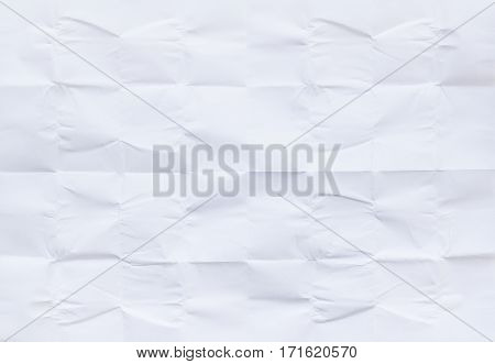 White sheet of paper folded in thirty-two white background and texture.