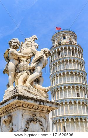 Pisa Tuscany Italy. Marble statue in front of the Leaning Tower of Pisa in Piazza dei Miracoli (Square of Miracles).