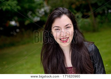 a happy young woman in the park