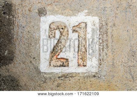 The Digits 21 With Concrete On The Sidewalk
