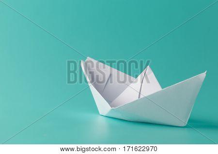 Paper Boat On Aquamarine Background
