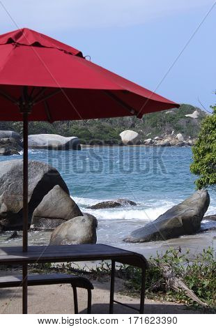 Chairs beach and umbrella next to the sea