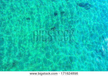 Turquoise water and surface of Aegean sea near Greek coastline