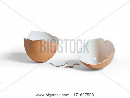 Image of broken brown eggshell on white background