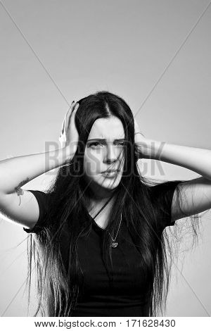 Pretty gothic girl posing over grey background
