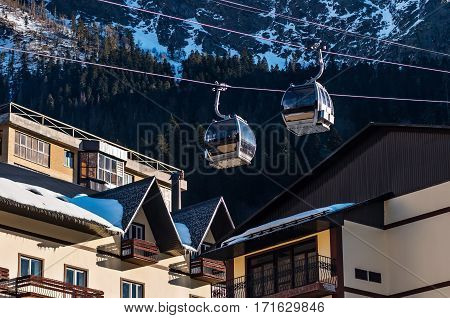 Cable cars lift at ski resort. sunny wether