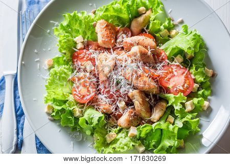 Delicious Caesar Salad With Chicken, Cherry Tomatoes And Parmesan Cheese