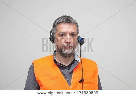 Senior Worker With Safety West and Voice Control Headset