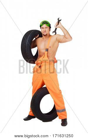 car mechanic with tools and tire, isolated against white background