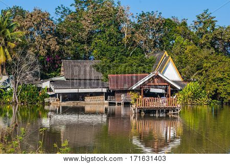 Old Wood Thai Style Pavilion Built on Lake