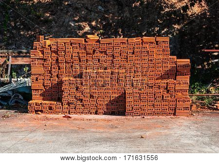 Stack of Brown Brick in Construction Site