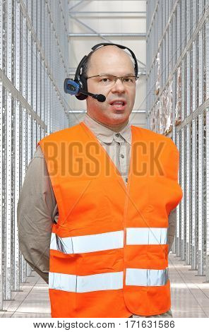 Pick by Voice Control Headset Man in Warehouse