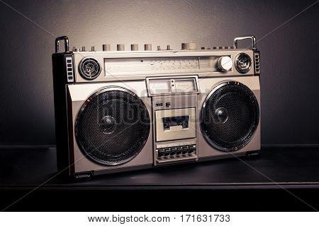Vintage radio boombox on dark background .