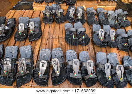 Many pairs of maasai shoes on african market Kenya