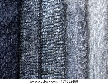 background from strips of blue jeans of different shades and brightness
