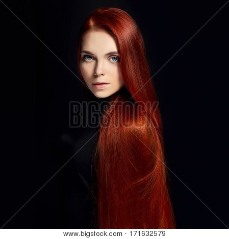 Sexy beautiful redhead girl with long hair. Perfect woman portrait on black background. Gorgeous hair and deep eyes. Natural beauty clean skin facial care and hair. Strong and thick hair