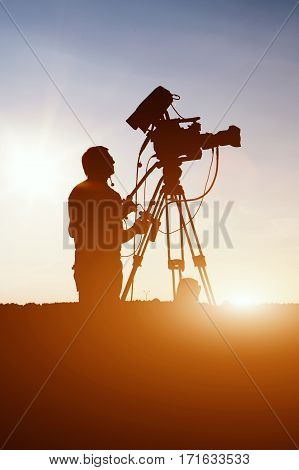 Cameraman Operator Shooting A Summer Rock Concert