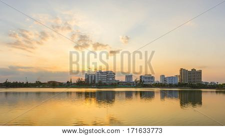 Photos Building River Town In Udon Thani Thailand golden sky background. Sun during sunset