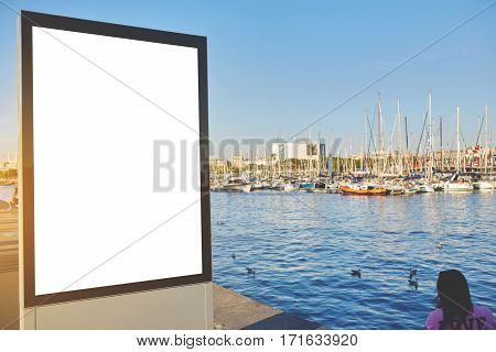 Blank billboard with copy space for your text message or content outdoors advertising mock up public information board at marina port. Empty Lightbox in urban setting