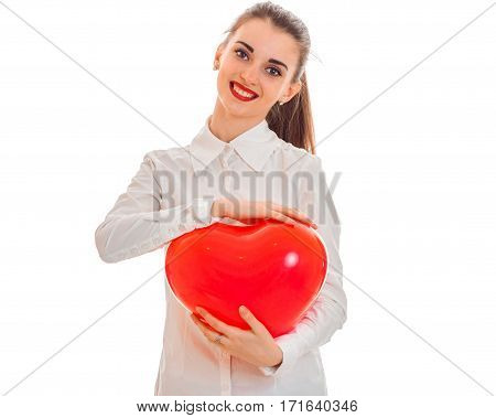 Cutie young brunette girl posing with red heart isolated on white . Saint Valentines Day concept. Love concept.