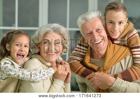 Portrait of grandparents with grandchildren close up