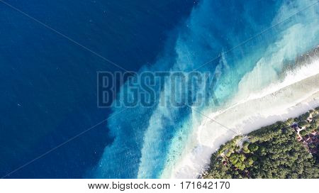 Top view aerial drone photo of one of the most beautiful beaches in the world incredibly beautiful blue water makes a fascinating picture while ocean current carries the white sand seabed. Background