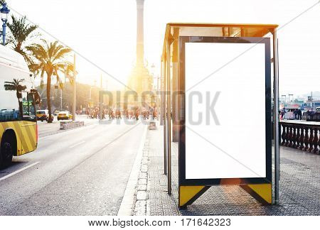 Empty billboard with copy space for your text message or promotional content electronic advertising mock up public information board outdoors on a bus stop blank poster in urban setting