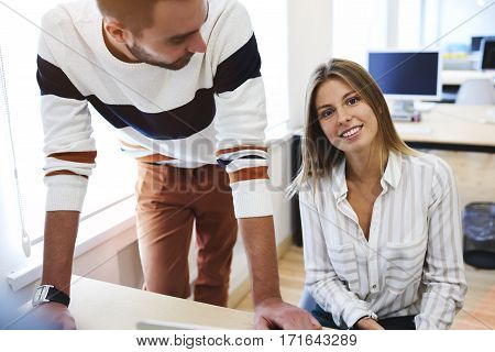 Male and female colleagues designers discussing ideas and sharing opinions about new landscape project finding compromise during working day on informal meetingmaking decisions in modern coworking