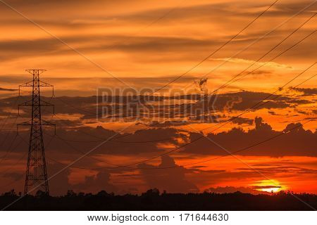 Beautiful sunset over high electric pole landscape