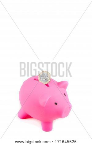 Piggybank with one Euro coin with copy space