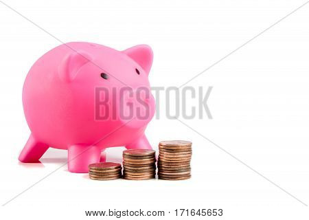 Piggybank with rasing stacks of coins and copy space