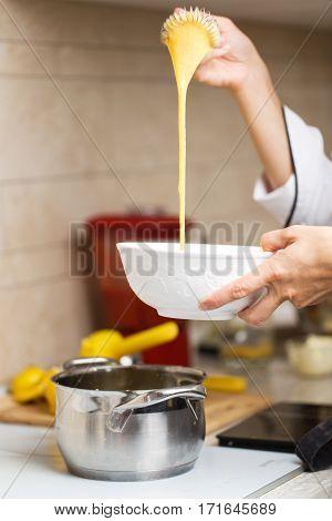 Breaking Eggs For Making Custard